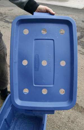 Worm bin with holes drilled out.